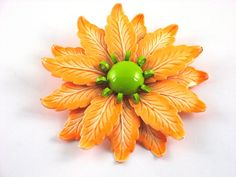 Vintage Retro Orange and Green Enamel Flower Power Pin Brooch.. available in our shop on Ruby Lane