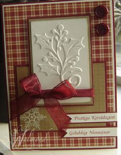 handmade Christmas card from Welmoed ... comfortable country look in kraft, cream and burgundy ... plaid paper ... embossing folder holly leaves and berries ... organdy ribbon wrap and bow ... great card!