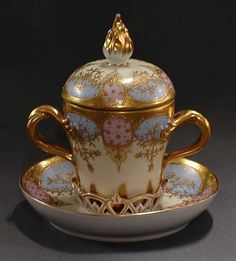 FINE DRESDEN PORCELAIN HOT CHOCOLATE CUP, COVER AND STAND<br>German. 20th Century. With raised gilt enamel vines, the stand with pierced gallery supporting the cup. (200/300)