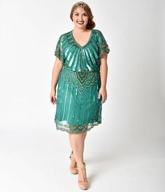 This gorgeous emerald green and glittering gold plus size flapper dress exudes 1920s and 30s charm, hand crafted in intricately beaded mesh layered over an included matching slip. With impressive swaths of deco