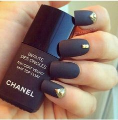 22 Black Nails That Look Edgy and Chic - A gorgeous matte black design with gold studs.