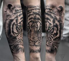 Green-eyed tiger tattoo by Niko Vaa