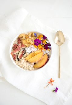 tropical bowl | replace yogurt with coconut milk | figs | golden raspberries | coconut | peaches | edible flower mix