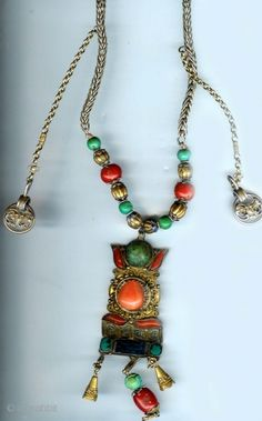 By Linda Pastorino   Designer necklace with Mongolian silver gilt, coral and lapis components from the mid 19th century   Sold