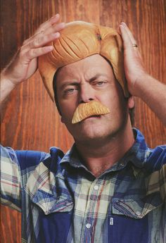 Yes, that is Nick Offerman, aka Ron Effn' Swanson, wearing a wood mustache and toupee. I just found out he is actually a woodworker in real life and the episode of Parks and Rec where it shows his character is his actual shop at his home! He just got even more awesome in my book.