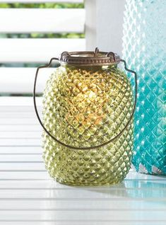 Iridescent light will enliven your room when a candle is lit in this fascinating lantern. Green glass pressed into a tactile diamond pattern is held aloft by a bronze-colored decorate hook system. Candle Lanterns, Tea Light Candles, Votive Candles, Tea Lights, Diamond Candles, National Holidays, Green Diamond, Diamond Pattern, Independence Day
