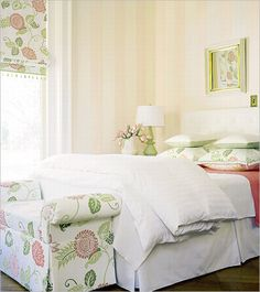 Subtle cream and rosewhite vertical stripes in a bedroom