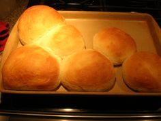 Bread Machine Hamburger Buns: 1 1/4 cup milk, slightly warmed; 1 beaten egg; 2 tblsp butter; 1/4 cup white sugar; 3/4 tsp salt; 3 3/4 cups bread flour; 1 1/4 tsp active dry yeast; Shape into buns. Place on greased baking sheet far apart and brush with melted butter. Cover and let rise until doubled, about one hour. Bake at 350 for 9 -12 minutes.