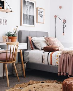 This is what happens when a modern bohemian bedroom meets global inspired decor. Theses room is neutral, relaxing and sophisticated. And of course, a hint of mid century modern peppered throughout. See More in