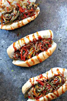 Grilled Bacon-Wrapped Beer Brats with Drunken Peppers and Onions from cravingsofalunatic.com- These Grilled Bacon-Wrapped Beer Brats with Drunken Peppers and Onions combine all of your favourite food in one delicious recipe. Fire up that grill and enjoy an epic dinner. @CravingsLunatic