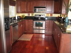 kitchen flooring material porcelain tile plank floors with cherry cabinets been 1704