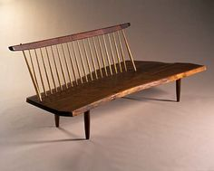 Conoid Bench by George Nakashima: Made of walnut and hickory, sophisticated rusticity. #Bench #George_Nakashima #Smithsonian