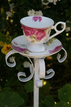 Beautiful Garden Decor Tea Cup Bird Feeder on Rod Iron Stand. $42.00, via Etsy.