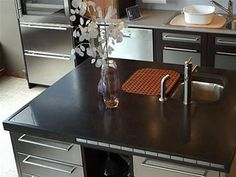 Someday I *WILL* have concrete countertops and a stainless steel kitchen