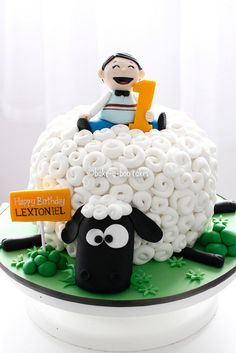 A sheep and a boy birthday cake