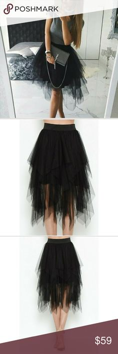 Mesh Tiered Skirt-Black This skirt features a tiered design of cascading mesh layers with an asymmetrical cut. Elastic waist. Partially lined. Skirts Asymmetrical