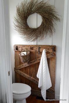 Towel storage on a gate / Bathroom storage ideas in Cabin Life! on FunkyJunkInteriors.net