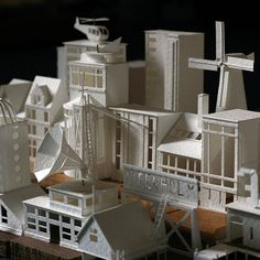 From an artist's mind springs a paper town  Read more: http://www.mnn.com/lifestyle/arts-culture/blogs/artists-mind-springs-paper-town#ixzz3jYmlTWmG   Charles Young's meticulous paper sculptures will awaken your inner child.