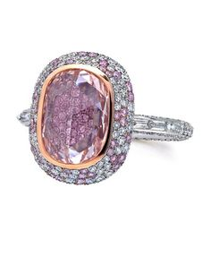 2.44 Carat Pink Oval #Diamond #Ring - Oval fancy pink, rose-cut diamond of 2.44 carats with a band of 6 baguette diamonds. Micro-set pink and white spotted border. Set in platinum and 18K rosegold.