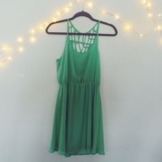 Mint Green Detailed Back Dress A lined mint green dress with a strappy back. Great condition, has only been worn once. Tobi Dresses Mini