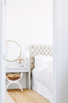 5 Tips for Mastering a Perfect White Bedroom// Kristin Kerr, tufted headboard, round mirror, fur stool