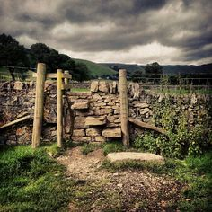A stone stile on a dull day in Castleton, Derbyshire.