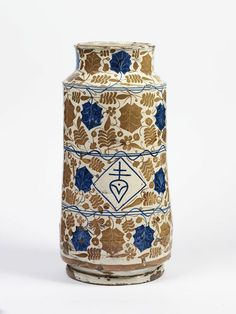 Drug jar (albarello), tin-glazed earthenware painted in cobalt blue and lustre, made in Valencia, Spain, 1435-1475