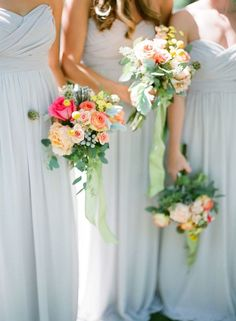 Blue and Peach Bridesmaids   Leslee Mitchell Photography   Coral Summer Wedding