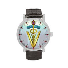 GOLDEN CADUCEUS VETERINARY SYMBOL / Aqua Blue Watches by Bulgan Lumini .,Elegant ,artistic.classy printed gold caduceus with entwined serpents,blue wings and 3D gem stones ,vibrant lights and fractal waves in teal,violet ,turquoise,pink,yellow,white colors.