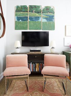 "A slender console replaced a bulky armoire. ""My biggest surprise was how removing the bigger storage pieces allowed for more targeted stowing and more living space,"" says Cole. The triptych was found on a Boston side street."