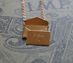 sweet brass envelope charm necklace on uncovet