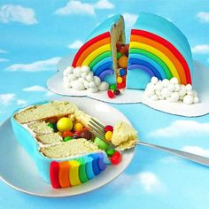 Rainbow cake with blue fondant and marshmallow clouds! So cute!