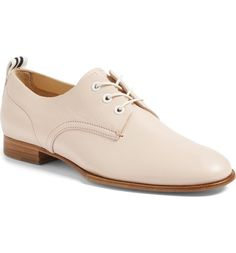 Energize your casual wardrobe with a modern, minimalist oxford grounded by a low, stacked heel.