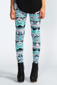 Emerald/ teal, black, white and grey aztec inspired leggings paired with wedged laced up heels amd a loose singlet of top