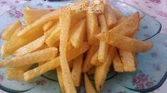 Malzemeler 4-5 adet patates 2 yemek kaşığı un 2 tatlı kaşığı mısır nişastası 1 paket kabartma tozu Tuz Kızartmak İçin Sıvı yağ