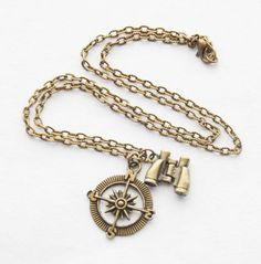 This handmade necklace features an antiqued brass compass charm and an articulated binoculars charm dangling from an antiqued brass chain. DETAILS: *Compass charm is approximately 1.15 or 29mm tall *Choose chain length in the notes to seller at checkout *Free gift wrapping included!  Add birthstone pendants here: https://www.etsy.com/listing/273631592/birthstone-charm-add-on-birthstone-charm?ref=shop_home_active_1  Feedback from my customers about my necklaces: So cute!! I love my necklace…