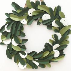 Handmade Papercut Mistletoe Christmas Wreath. This gorgeous handmade papercut mistletoe christmas wreath is the perfect finishing touch for your festive decor!