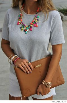 Neutrals with bright colored statement necklace and beautiful clutch