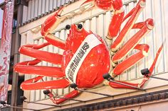 Crab Restaurant in Dotonbori, #Osaka's famous foodie district with an eye-watering amount of neon lights and crazy billboards! #Japan