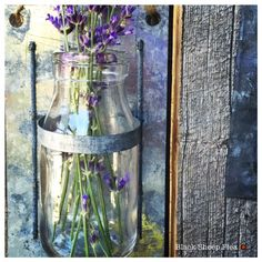 Love these hanging flower jars and distressed metal holder. :))