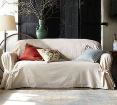 tie-arm loose-fit slipcover (i wonder if i could make this from canvas, its $139 from pottery barn...)
