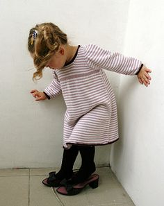 She'll look fresh and adorable in a stockinette t-shirt dress with back opening