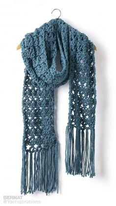 Crossing Paths Crochet Super Scarf - Patterns | Yarnspirations | This textured crochet scarf in Bernat Softee Chunky has some fun fringe swinging from the bottom. This is a great scarf for those cold fall nights!