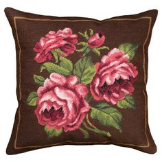 Add a pop of pattern to your sofa, chaise, or settee with this lovely wool pillow, showcasing a floral motif in brown.  Product: