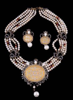 An Indian cultured pearl, diamond and ruby necklace and