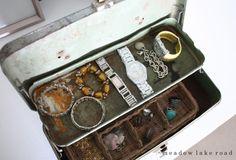 Vintage metal toolbox repurposed as a dresser top jewelry box.