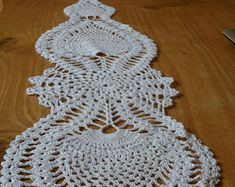 Free Pineapple Crochet Table Runner Pattern | Free Rounded Crochet Pattern 22 300x286 Free Crochet Doily Pattern