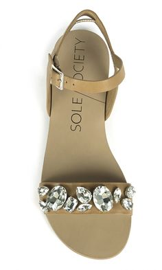 Tan leather slingback sandals bejeweled with rhinestones along the front and an adjustable ankle strap. Perfect for spring & summer.