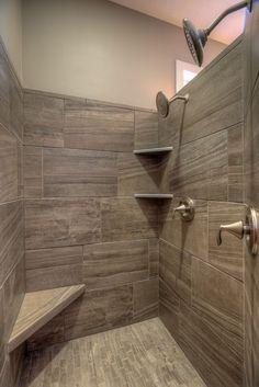 walk-in tile master shower with corner seat and corner shelves. 2 shower heads.
