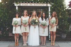 Eclectic Ivory Lace Bridesmaid Dresses and I LOVE THE DIY FLOWERS. MY colors will be more various and include more tans/beige